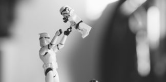 Close up image of LEGO characters, small Darth Vader, and stormtrooper with baby trooper